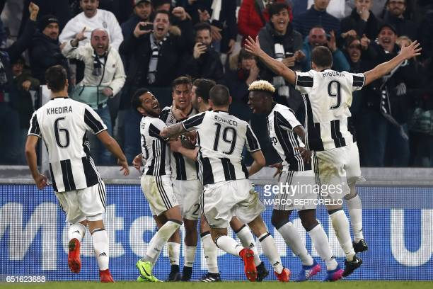 Juventus' forward from Argentina Paulo Dybala celebrates with teammates after scoring during the Italian Serie A football match Juventus Vs AC Milan...