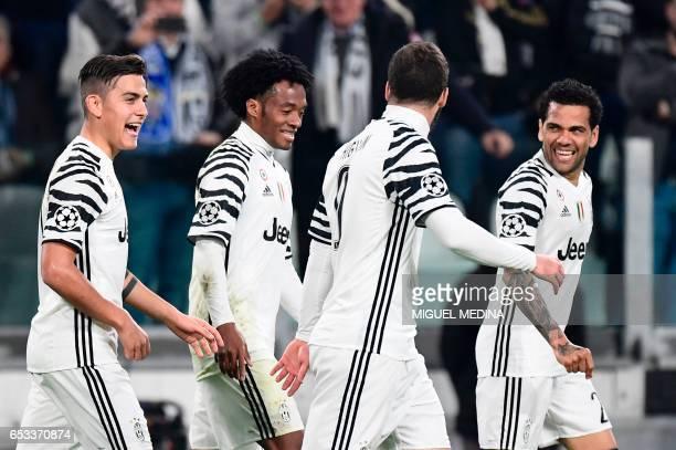 Juventus' forward from Argentina Paulo Dybala celebrates with teammates Juventus' forward from Colombia Juan Cuadrado Juventus' forward from...