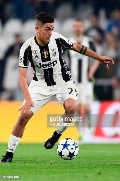 Juventus' forward from Argentina Paulo Dybala controls the ball during the UEFA Champions League quarter final first leg football match Juventus vs...