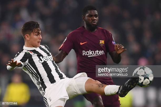 Juventus' forward from Argentina Paulo Dybala controls the ball next to Barcelona's French defender Samuel Umtiti during the UEFA Champions League...