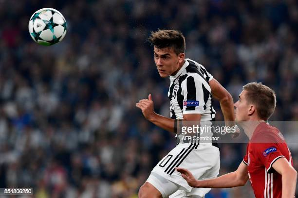 Juventus' forward from Argentina Paulo Dybala heads the ball during the UEFA Champion's League Group D football match Juventus vs Olympiacos on...