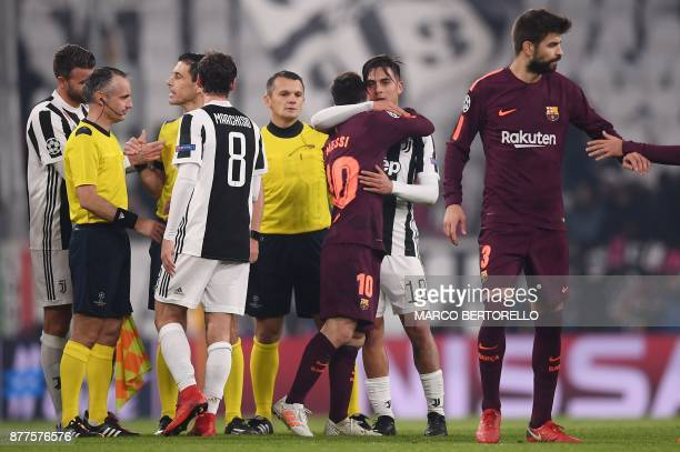 Juventus' forward from Argentina Paulo Dybala hugs Barcelona's Argentinian forward Lionel Messi at the end of the UEFA Champions League Group D...