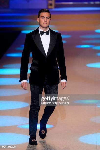 Juventus' forward from Argentina Paulo Dybala presents a creation for fashion house Dolce Gabbana during the Men's Fall/Winter 2019 fashion shows in...