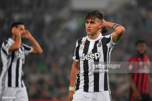 Juventus' forward from Argentina Paulo Dybala reacts during the Italian Tim Cup final Juventus vs AC Milan at the Olympic stadium on May 9 2018 in...