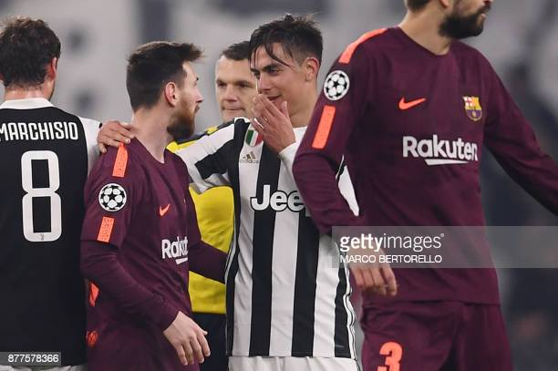 Juventus' forward from Argentina Paulo Dybala speaks with Barcelona's Argentinian forward Lionel Messi at the end of the UEFA Champions League Group...