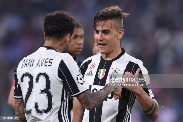 Juventus' forward from Argentina Paulo Dybala speaks with Juventus Defender from Brazil Dani Alves during the UEFA Champions League semi final second...