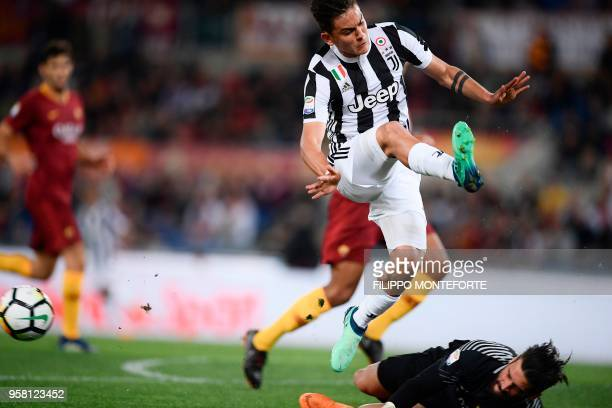 Juventus' forward from Argentina Paulo Dybala tries to score against Roma's Brazilian goalkeeper Alisson during the Italian Serie A football match AS...
