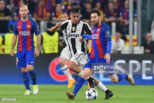 Juventus' forward from Argentina Paulo Dybala vies with Barcelona's Argentinian forward Lionel Messi during the UEFA Champions League quarter final...