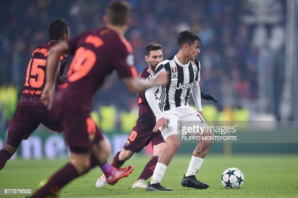Juventus' forward from Argentina Paulo Dybala vies with Barcelona's Argentinian forward Lionel Messi during the UEFA Champions League Group D...