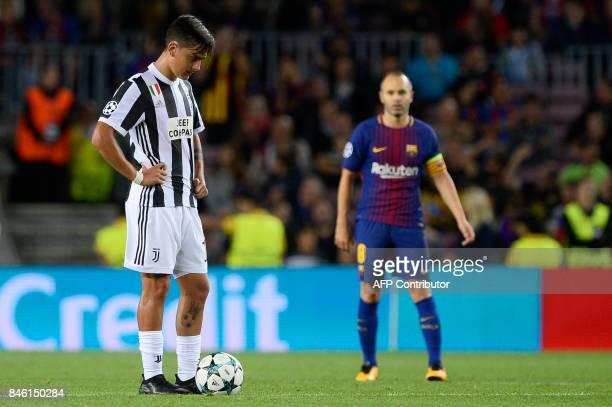 Juventus' forward from Argentina Paulo Dybala waits to kick off after Barcelona's third goal during the UEFA Champions League Group D football match...