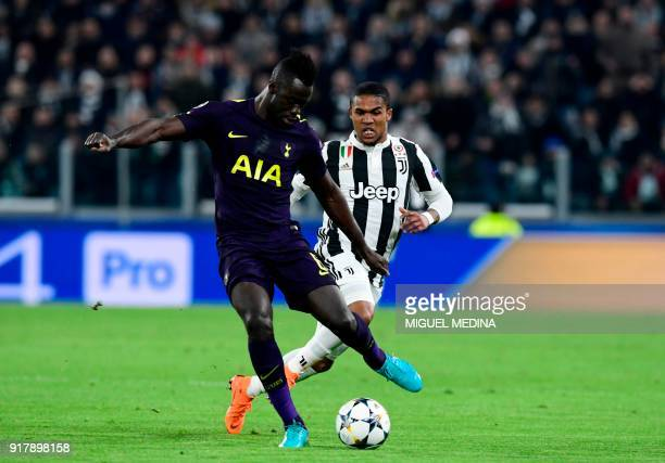 Juventus' forward from Brazil Douglas Costa fights for the ball with Tottenham Hotspur's Colombian defender Davinson Sanchez during the UEFA...