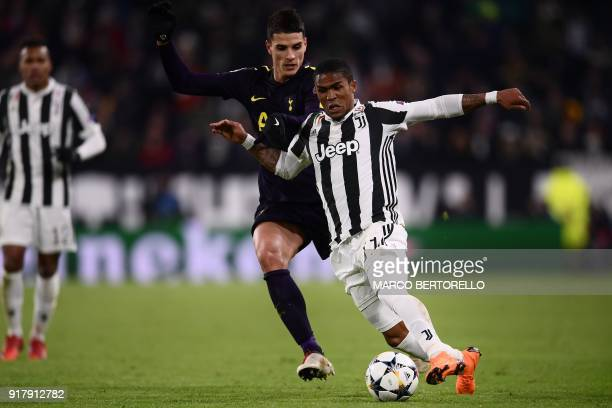 Juventus' forward from Brazil Douglas Costa fights for the ball with Tottenham Hotspur's Argentinian midfielder Erik Lamela during the UEFA Champions...
