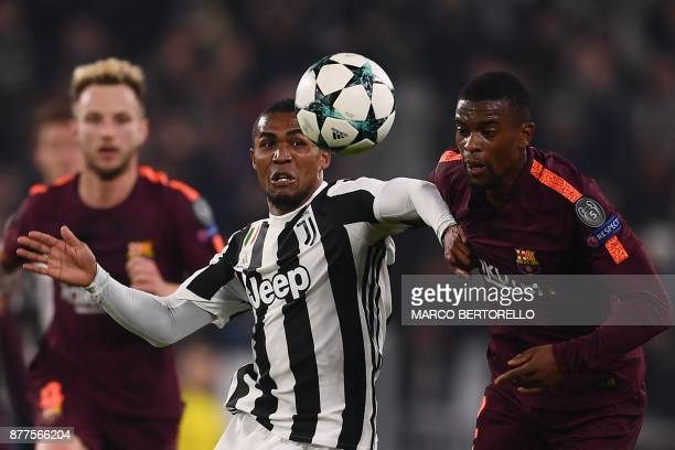Juventus' forward from Brazil Douglas Costa vies with Barcelona's Portuguese defender Nelson Semedo during the UEFA Champions League Group D football...
