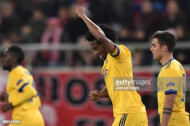 Juventus' forward from Colombia Juan Cuadrado celebrates after scoring a goal during the UEFA Champions League group D football match Olympiacos FC...