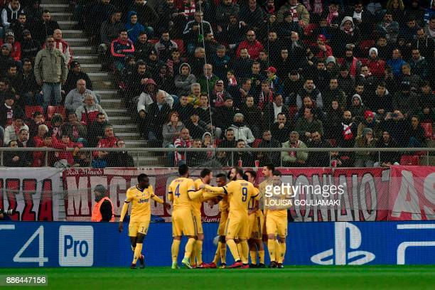 Juventus' forward from Colombia Juan Cuadrado celebrates with teammates after scoring a goal during the UEFA Champions League group D football match...