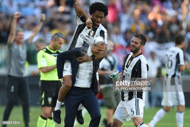Juventus' forward from Colombia Juan Cuadrado celebrates with Juventus' coach from Italy Massimiliano Allegri and Juventus midfielder Miralem Pjanic...