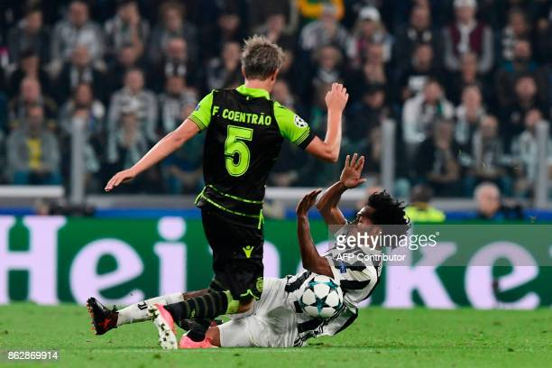 Juventus' forward from Colombia Juan Cuadrado fights for the ball with Sporting's midfielder Fabio Coentrao during the UEFA Champions League Group D...