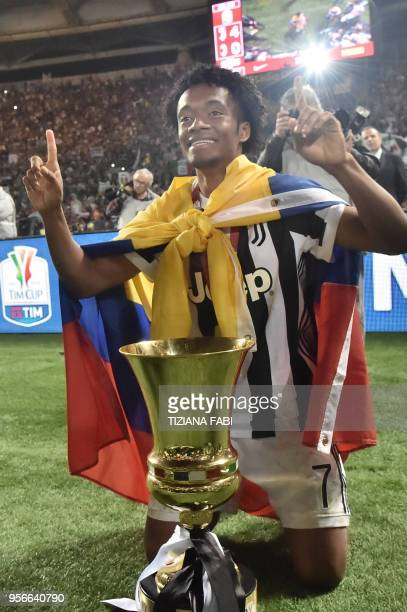 Juventus' forward from Colombia Juan Cuadrado poses with the trophy after winning the Italian Tim Cup final Juventus vs AC Milan at the Olympic...