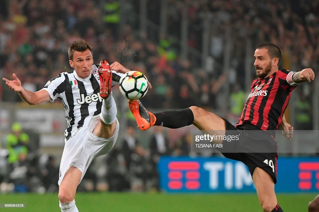 Juventus' forward from Croatia Mario Mandzukic (L) fights for the ball with AC Milan's defender Leonardo Bonucci during the Italian Tim Cup (Coppa Italia) final Juventus vs AC Milan at the Olympic stadium on May 9, 2018 in Rome.