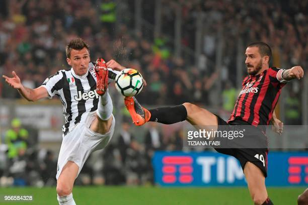 Juventus' forward from Croatia Mario Mandzukic fights for the ball with AC Milan's defender Leonardo Bonucci during the Italian Tim Cup final...