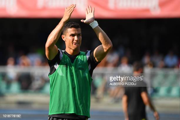 Juventus' forward from Portugal Cristiano Ronaldo acknowledges cheering fans prior to the Italian Serie A football match AC Chievo vs Juventus at the...