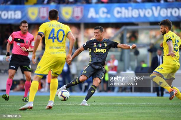 TOPSHOT Juventus' forward from Portugal Cristiano Ronaldo kicks the ball during the Italian Serie A football match AC Chievo vs Juventus at the...