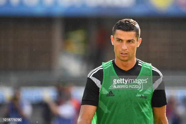 Juventus' forward from Portugal Cristiano Ronaldo looks on as he warms up prior to the Italian Serie A football match AC Chievo vs Juventus at the...