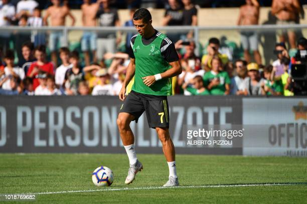 TOPSHOT Juventus' forward from Portugal Cristiano Ronaldo warms up prior to the Italian Serie A football match AC Chievo vs Juventus at the...