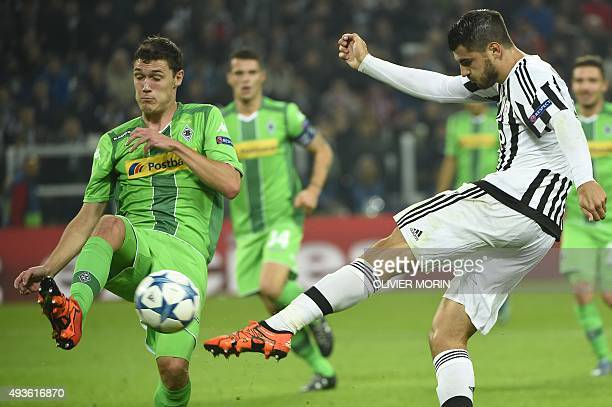 Juventus' forward from Spain Alvaro Morata kicks the ball in front of Moenchengladbach's Danish defender Andreas Bodtker Christensen during the UEFA...