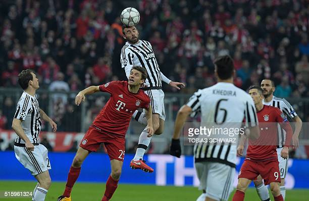 Juventus' forward from Spain Alvaro Morata vies with Bayern Munich's midfielder Thomas Mueller during the UEFA Champions League Round of 16 second...