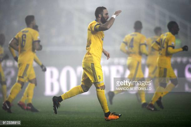 Juventus' forward Gonzalo Higuain from Argentina celebrates after scoring a goal during the Italian Tim Cup football match between Atalanta and...