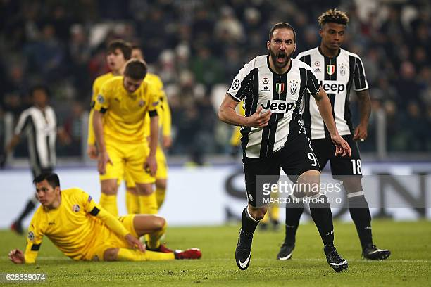 Juventus' forward Gonzalo Higuain from Argentina celebrates after scoring during the UEFA Champions League football match Juventus Vs GNK Dinamo...