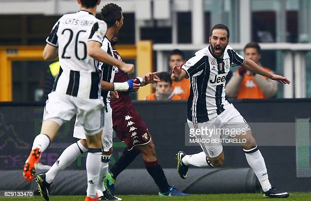 Juventus' forward Gonzalo Higuain from Argentina celebrates after scoring during the Italian Serie A football match between Torino and Juventus at...