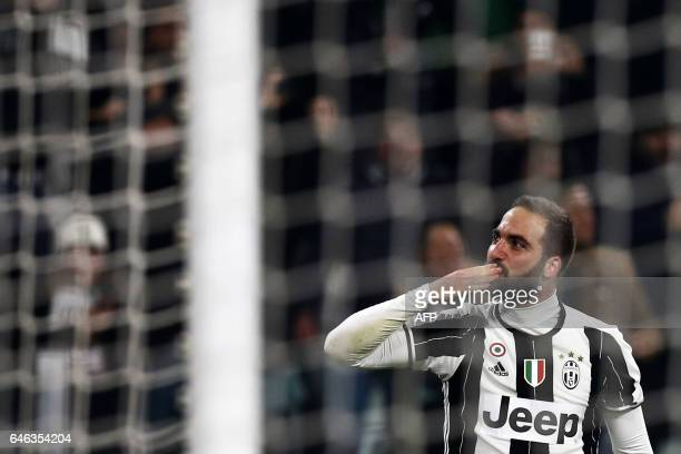 Juventus' forward Gonzalo Higuain from Argentina celebrates after scoring during the Italian Tim Cup football match between Juventus and Napoli on...