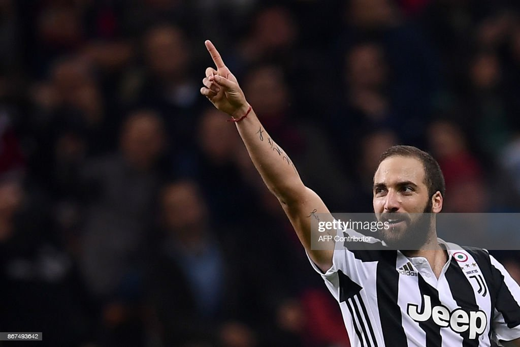 Juventus' forward Gonzalo Higuain from Argentina celebrates after scoring during the Italian Serie A football match AC Milan Vs Juventus on October 28, 2017 at the 'Giuseppe Meazza' Stadium in Milan. /