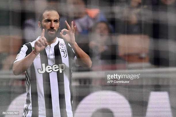 Juventus' forward Gonzalo Higuain from Argentina celebrates after scoring during the Italian Serie A football match AC Milan Vs Juventus on October...
