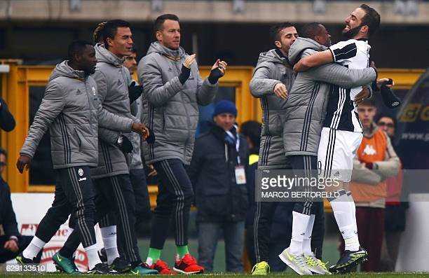 Juventus' forward Gonzalo Higuain from Argentina celebrates with teammates after scoring during the Italian Serie A football match between Torino and...