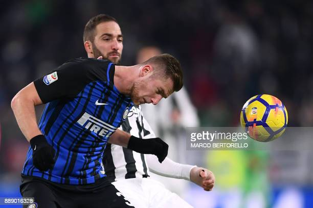 Juventus' forward Gonzalo Higuain from Argentina fights for the ball with Inter Milan's defender Milan Skriniar from Slovenia during the Italian...