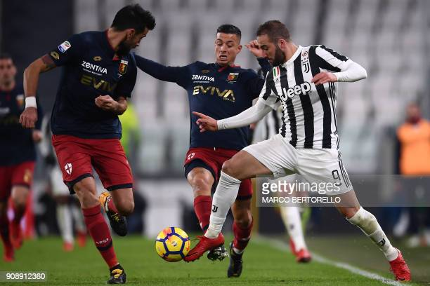 Juventus' forward Gonzalo Higuain from Argentina fights for the ball with Genoa's defender Armando Izzo during the Italian Serie A football match...