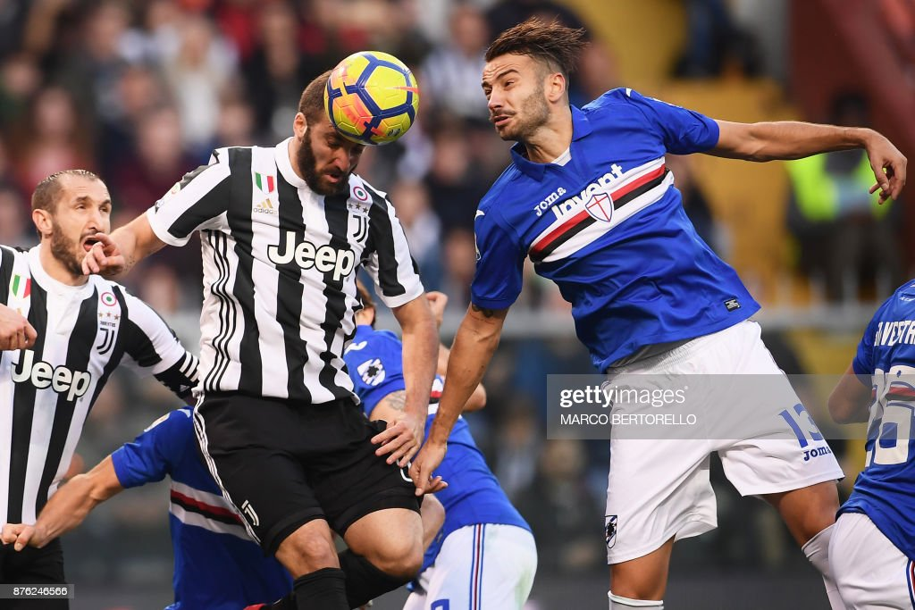 TOPSHOT - Juventus' forward Gonzalo Higuain from Argentina (L) jumps for the ball with Sampdoria's defender Gian Marco Ferrari during the Italian Serie A football match Sampdoria Vs Juventus on November 19, 2017 at the 'Luigi Ferraris' Stadium in Genoa. /