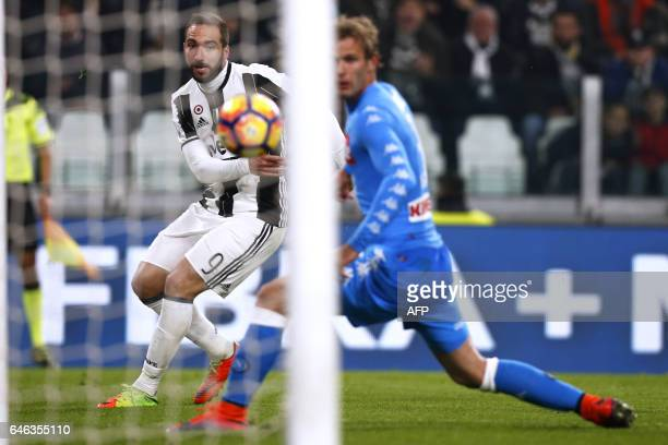 Juventus' forward Gonzalo Higuain from Argentina scores a goal during the Italian Tim Cup football match between Juventus and Napoli on February 28...
