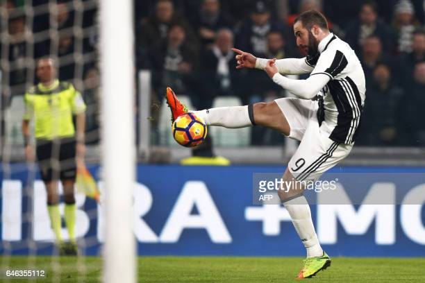TOPSHOT Juventus' forward Gonzalo Higuain from Argentina scores a goal during the Italian Tim Cup football match between Juventus and Napoli on...