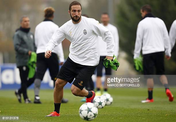 Juventus' forward Gonzalo Higuain from Argentina takes part in a training session on the eve of a UEFA Champions League football match against...