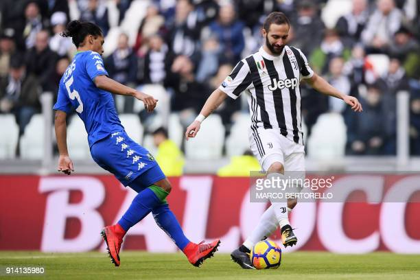 Juventus' forward Gonzalo Higuain from Argentina vies with Sassuolo's defender Mauricio Lemos from Uruguay during the Italian Serie A football match...