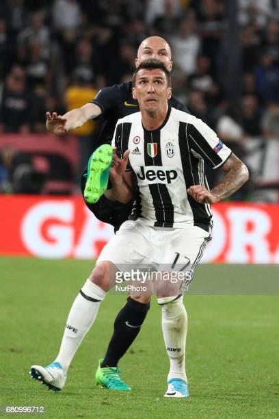 Juventus forward Mario Mandzukic fights for the ball against Monaco defender Andrea Raggi during the Uefa Champions League semi final football match...