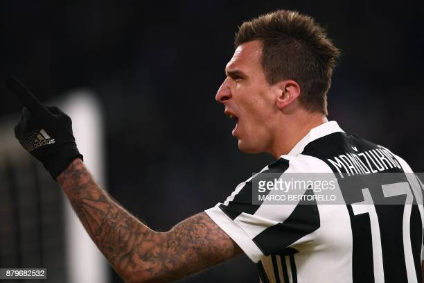 Juventus' forward Mario Mandzukic from Croatia celebrates after scoring during the Italian Serie A football match Juventus Vs Crotone on November 26...
