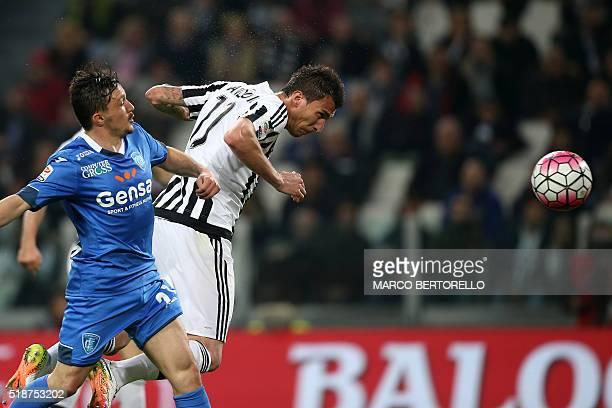 Juventus' forward Mario Mandzukic from Croatia scores during the Italian Serie A football match Juventus Vs Empoli on April 2 2016 at the 'Juventus...