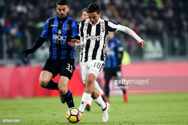 Juventus forward Paulo Dybala fights for the ball against Atalanta midfielder Leonardo Spinazzola during the Coppa Italia semi final football match...
