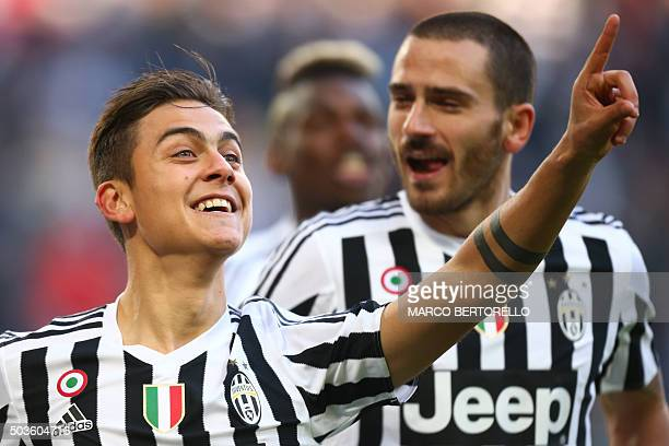 Juventus' forward Paulo Dybala from Argentina celebrates after scoring with Juventus' defender Leonardo Bonucci during the Italian Serie A football...