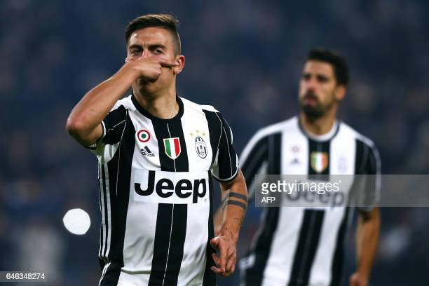 Juventus' forward Paulo Dybala from Argentina celebrates after scoring during the Italian Tim Cup football match between Juventus and Napoli on...